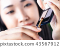 A woman is drawing eyebrows. 43567912