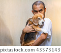 Asian man cherish carrying adorable beagle dog. 43573143