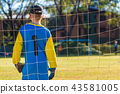 Young goalkeeper boy standing guard his goal 43581005