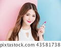 a pretty girl take lipstick 43581738