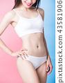 woman show her thin waist 43581906