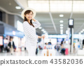 Young woman (airport) 43582036