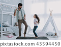 Handsome Young Father Dancing with Little Girl 43594450