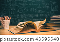 Open books with formulas on the chalkboard 43595540