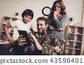 Disabled Man Soldier Watch A Tablet With Family. 43596401
