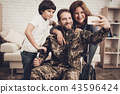 Disabled Male Soldier Is Making A Family Selfie. 43596424
