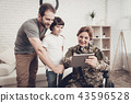 Disabled Woman Soldier Watch A Tablet With Family. 43596528