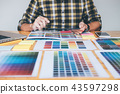 Creative graphic designer using graphics tablet to choosing colo 43597298