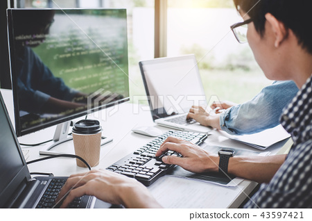 Programmers cooperating at Developing programming and website wo 43597421