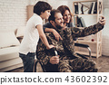 Disabled Male Soldier Is Making A Family Selfie. 43602392