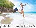 Sexy woman in the blue bikini on beach 43603677