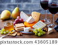 Assortment of cheese, grapes with red wine in glasses. Wooden background. 43605189