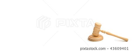 Wooden judge hammer on a white background.  43609401