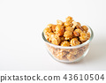 Caramel popcorn with cashew nuts and almonds 43610504