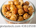 Caramel popcorn with cashew nuts and almonds 43610508