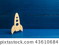 A wooden rocket on a blue background.  43610684