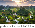 Stunning sunset over karst formations landscape near Yangshuo Ch 43611354