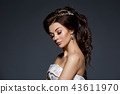 beautiful bride in wedding gown on grey background 43611970