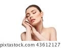 girl applying moisturizing cream isolated on white 43612127