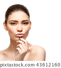 girl applying pink lipstick isolated on white 43612160