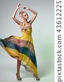 beautiful girl in dress posing like doll 43612225