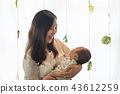 Asian young mother holding her baby in the bosom 43612259