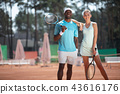 Positive couple are playing sport jointly outdoor 43616176