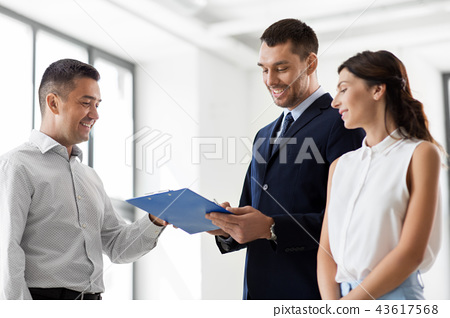 realtor showing contract document to customers 43617568