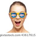 woman in sunglasses with las vegas sign reflection 43617615