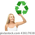 happy woman drawing green recycle symbol 43617638