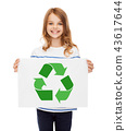 girl with picture of green recycle symbol on paper 43617644