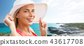 portrait of woman in sun hat over exotic beach 43617708