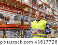 manual worker with tablet pc at warehouse 43617726
