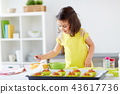little girl baking muffins at home 43617736