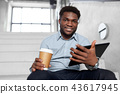 businessman with tablet pc and coffee on stairs 43617945