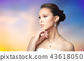 beautiful asian woman with earring and pendant 43618050