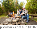 happy family roasting marshmallow over campfire 43618102