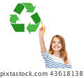 happy girl with brush drawing green recycle symbol 43618138