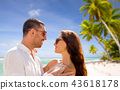 happy couple in sunglasses over tropical beach 43618178
