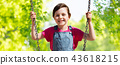 girl swinging on swing over natural background 43618215