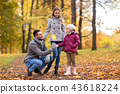happy family with maple leaf at autumn park 43618224