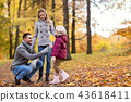 happy family with maple leaf at autumn park 43618411