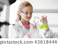 girl studying test tube at school laboratory 43618446