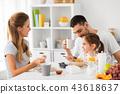 happy family having breakfast at home 43618637