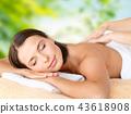 close up of beautiful woman having massage at spa 43618908