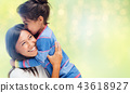 happy mother and daughter hugging and kissing 43618927