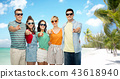 friends pointing finger at you over exotic beach 43618940