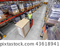 loader operating forklift at warehouse 43618941