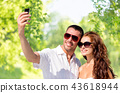 smiling couple making selfie by smartphone 43618944