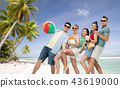 friends with beach supplies over exotic landscape 43619000